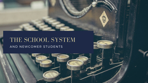a picture shows keyboard and sentence the school system and newcomer students